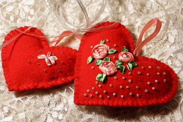 Red heart made of felt with embroidery. Handmade.