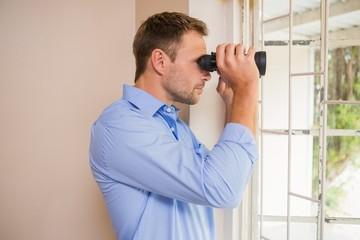 Man looking through a binoculars