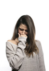 Portrait of a young woman coffing,sneezing, allergy, in sweater