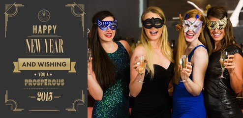 Friends wearing masks holding champagne glasses