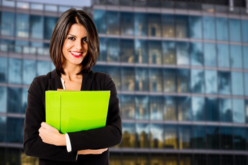 smiling business woman at her office building