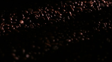 fresh roasted coffee beans background with spotlight