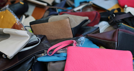 cases and leather bags of various sizes on sale in the market