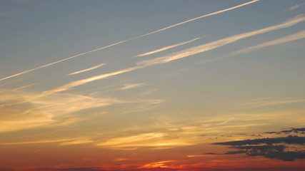 Time lapse shot of the traces of the aircraft at sunset