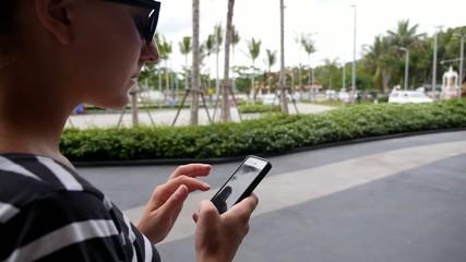 Woman Use Smart Phone Walking in Modern City.