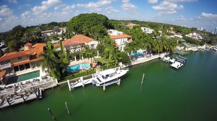 Aerial mansions and boats in the water