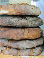 large loaves of genuine Apulian bread for sale in Italian bakery