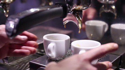 Barman making cups of espresso coffee