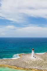 Small White Lighthouse on Sandy Peninsula
