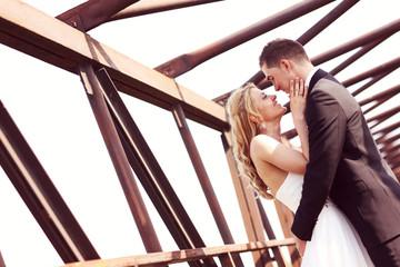 Bride and groom on a bridge