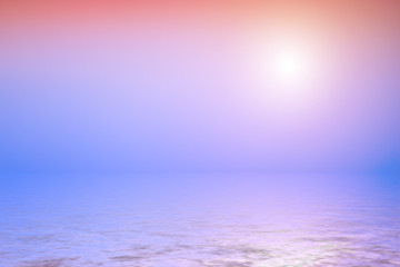 Sunset, pink sky with sun reflected in water.
