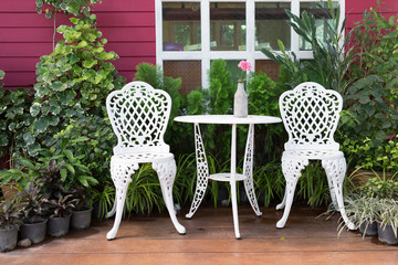 set of white furniture with table and chairs decorated in backya
