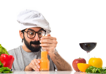 Crazy hipster chef making orange juice