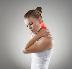 Young woman suffering from neck cramp. Nape pain and treatment