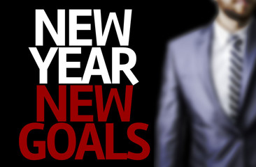 Business man with the text Great Ideas New Year New Goals