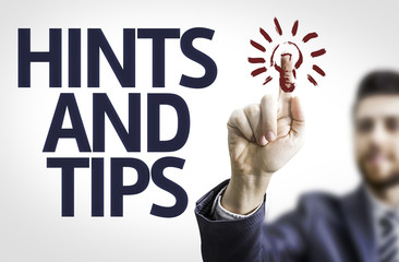 Business man pointing the text: Hints and Tips