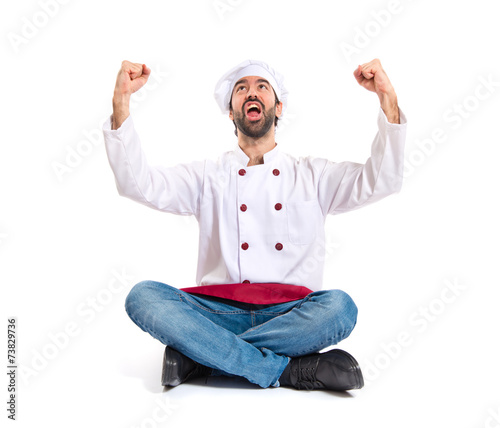 Lucky chef over isolated white background - 73829736