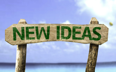 New Ideas sign with a beach on background