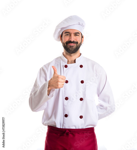 Chef with thumb up over white background - 73829977