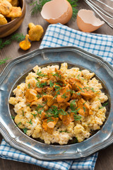 scrambled eggs with chanterelles and fresh dill, top view