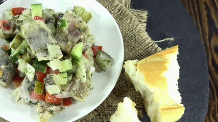 Portion of homemade Herring Salad (loopable) as 4K UHD footage