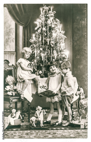 happy kids with christmas tree, gifts and vintage toys. antique - 73831590