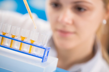 young women science professional pipetting sol