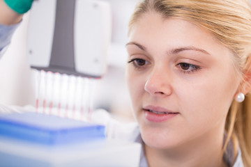 young women science professional pipetting