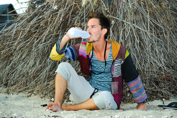 fashion handsome man relaxing on beach