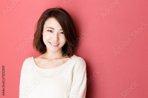 attractive asian woman on red background