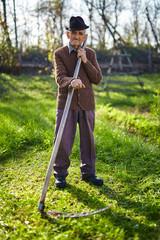 Old farmer with scythe