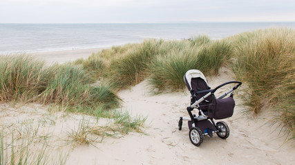 Baby stroller standing at a beach