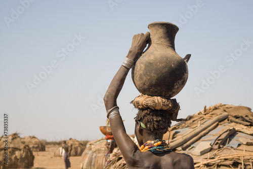 Fotobehang Overige Woman carries on her head a container with water, Ethiopia