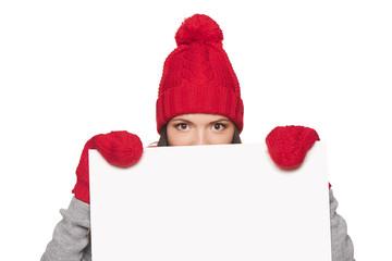 Winter woman peeking out of whiteboard