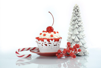 Happy Christmas red velvet cupcake with cherry and tree