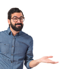 Young hipster man having doubts over white background