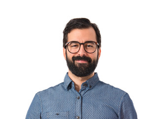 Happy young hipster man over white background