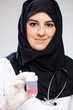 Young muslim doctor with medicines