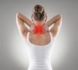 Leinwanddruck Bild - Injured neck. Young female suffering from spine disease.