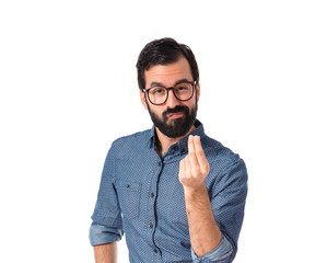 Young hipster man doing money gesture