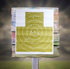 Military shooting target with bullet holes.
