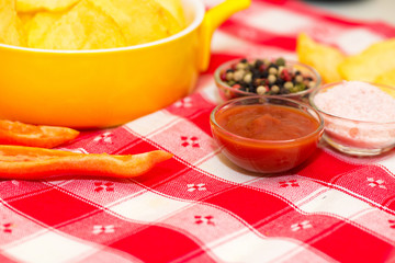 Ketchup, chips, salt and peppers