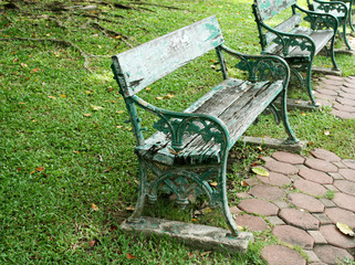 metal and wood garden chair on green grass