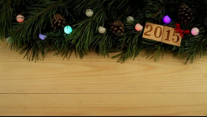 """Christmas tree branch, flashing garland with text """"2015"""""""