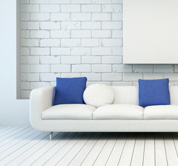White Couch against brick wall at Living Room