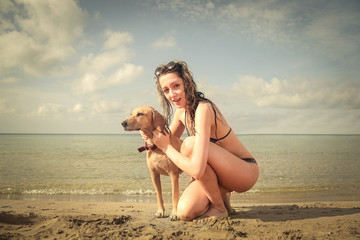 A girl and her dog at the beach