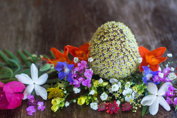 Decorated Easter egg with fresh blooming flowers