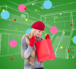 Blonde in winter clothes looking in shopping bag