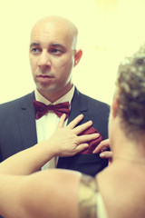 Handsome groom preparing for his wedding day
