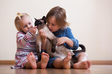 sisters  with cat